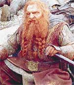 КАДР ИЗ К/Ф &#034ВЛАСТЕЛИН КОЛЕЦ&#034: гном Гимли славу завоевывал мечом, а не слуховым аппаратом